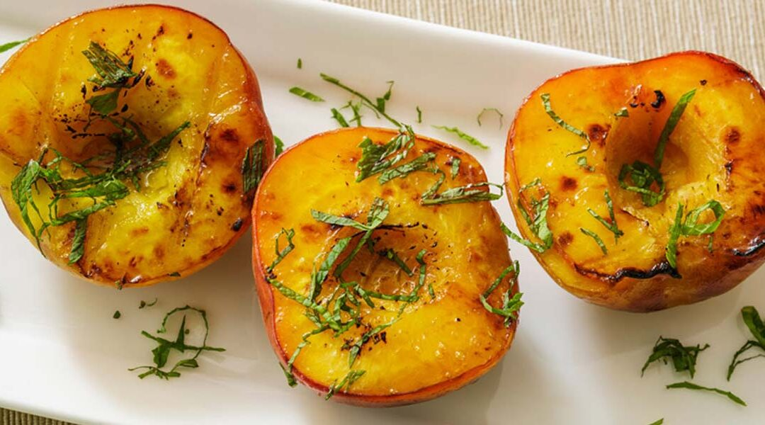 Grilled Peaches with Black Pepper and Basil-Lime Drizzle